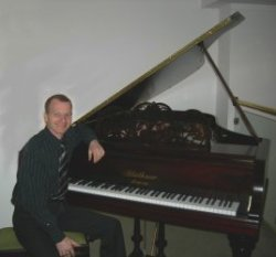 Martin with a piano